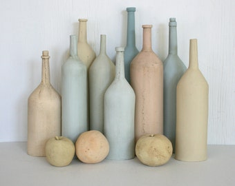 Mundane. Ceramic still life with bottles and fruit. Blue, tan, yellow, natural, neutral, pastel, rustic, beach decor, modern.