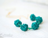 Emerald green necklace with fabric beads