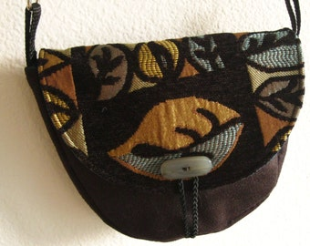 small purse with leaf pattern in black, greens and turquiose