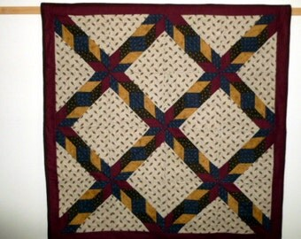 Hand quilted  Crossed Celtic Knot table topper or wall hanging blue dark red gold and brown