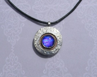 Leather adjustable length cord with blues and purples dichroic glass center