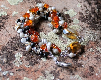 Amber textures bracelet / wire wrapped beads / heishi seashells / feldspar / grey pearls / orange amber / black wood / adjustable