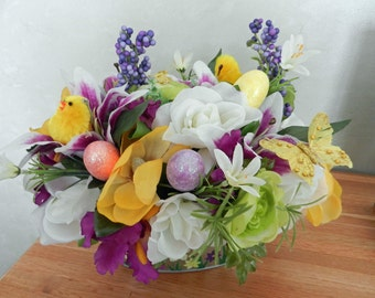 SALE Easter centerpiece filled with purple yellow and white flowers and yellow butterflies, chicks and easter eggs