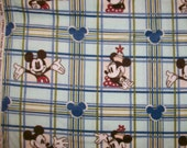 A Disney Classic Mickey And Minney Mouse Fleece Fabric Sold By The Yard Free US Shipping