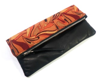 Abstract Foldover Clutch/Leather Trim