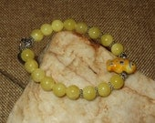 Yellow Ceramic Fish Stretch Bracelet with Yellow Jade Beads, Silvertone Spacers & Heart Charm