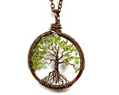 The Spindly Roots Petite Tree of Life Antiqued Copper Necklace in Peridot.