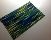 Dog Snood cool stretch fabric in bright blues greens and yellow. Standard and Miniature poodle size both available