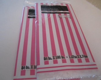 PLASTIC TABLE COVERS Decorated in a Pink and White Stripe