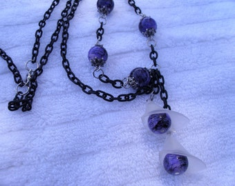 Deep purple beaded necklace with frosted acrylic flowers