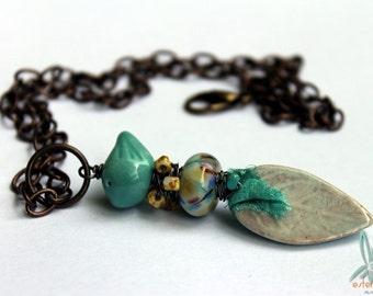 Stacked pendant, ceramic leaf, ceramic bird, lampwork glass bead, aqua, neutral, boho necklace by Esfera jewelry