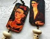 Earrings of photos of Frida Kahlo with skull bead hanging underneath. 4 views of Frida.