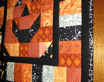 Smiling Jack-O-Lantern Wall Hanging or Table Topper with White Spider web binding.