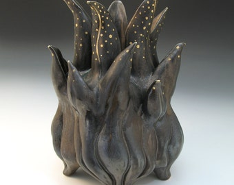 Bronze glazed spikey porcelain vessel with gold luster polka dots