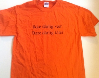 "Norwegian Saying Shirt Roughly Translated: ""there's no bad weather, only bad clothing"" Adult bright orange"