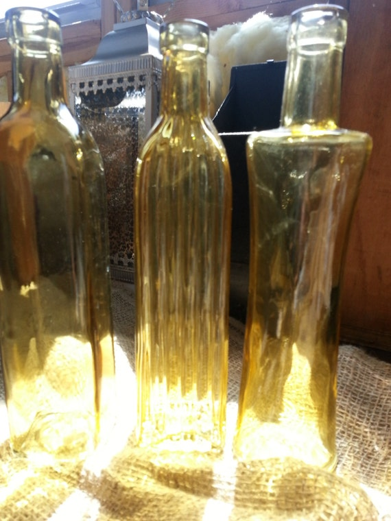 Amber yellow decorative colored glass bottles by bertolibridal for Colored bottles for decorations