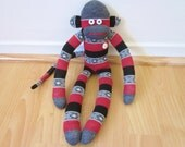 Red, gray, and black striped southwestern print sock monkey plush