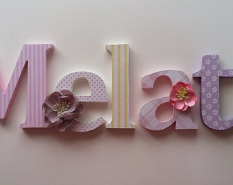 Wooden  letters for nursery in  yellow,lavender pink and green