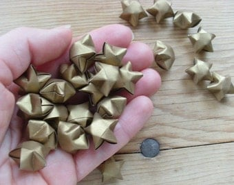 Gold Origami Stars, set of 24.