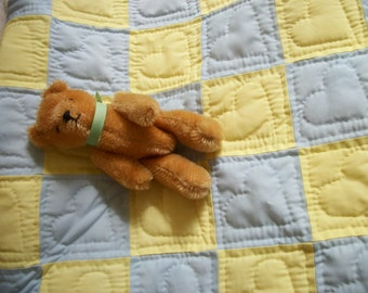Blue and yellow baby quilt, with hearts