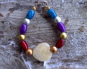 Calcite heart,glass,metal beaded bracelet 8 inch