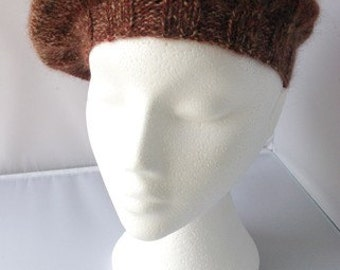 Women's hand knitted brown, fawn and rust self patterning wool beret.