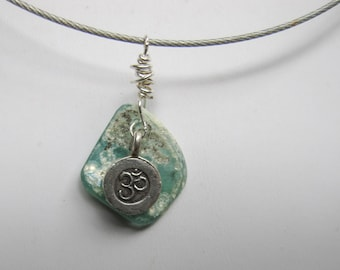 Cable wire necklace with wire-wrapped Roman Glass and Om pendant