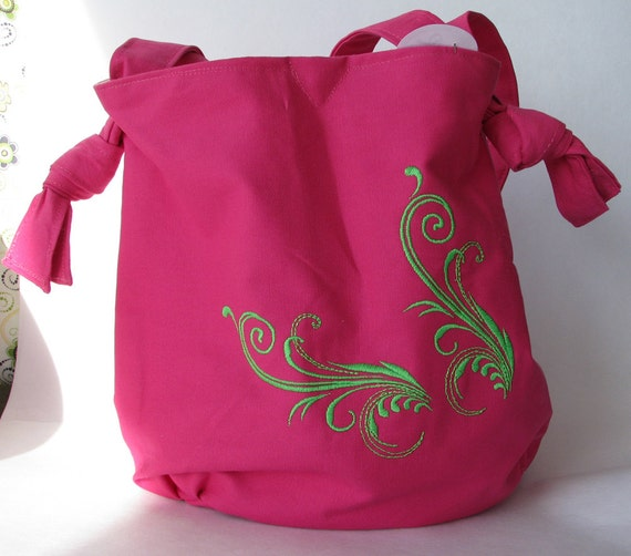 Hot pink purse with adjustable strap and lime green swirls