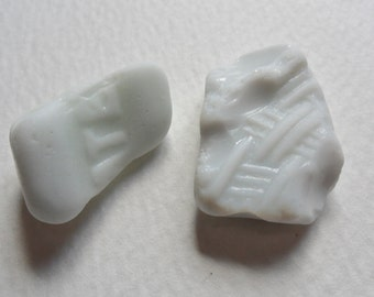 2 textured relief lettered white milk sea glass - Lovely English beach find pieces