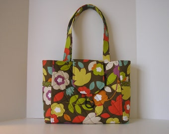 Bright Flowers and Leaves Print on a Brown Background Quilted Shoulder Bag
