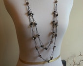 faceted bead necklace, gold, black, silver