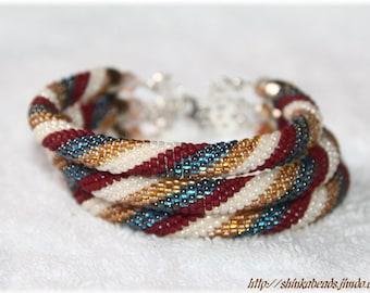 Bead crochet bracelet beige, blue and cinamon three strands