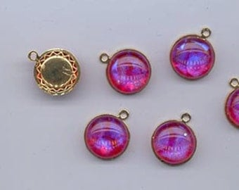 Beautiful cabochon pendant set featuring shimmering artisan-made dichroic glass -  red with blue/purple glow