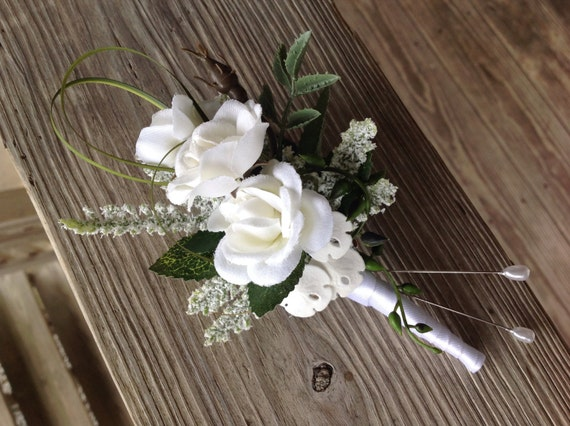 Kayla's Wedding Boutonniere in White Rose with Sand Dollars and Tropical Foliages