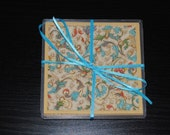 Set of Italian coasters with blue accents and gold edge