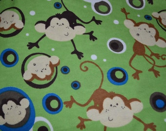 Green Monkey snuggle flannel fabric - sold by the yard