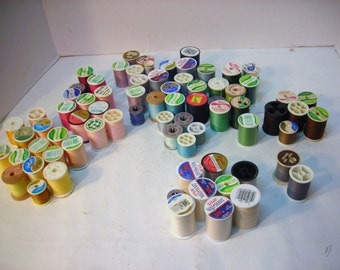 Lot of 75 Spools of Polyester Thread Mostly Pastels and Whites Some Darker Colors
