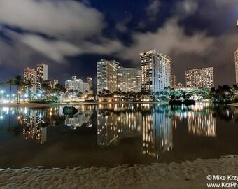 Hotels Reflecting off the Water of the  Duke Kahanamoku Lagoon at Night in Waikiki, Honolulu, Oahu, Hawaii