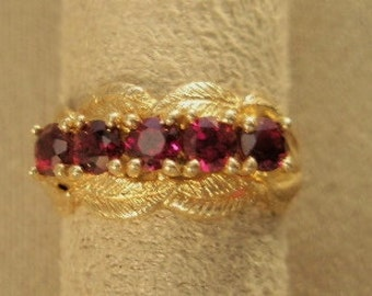 14 karat  Gold ring with five round Garnets nestled in leaves