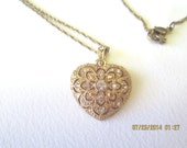 Heart necklace of gold filigree and rhinestones