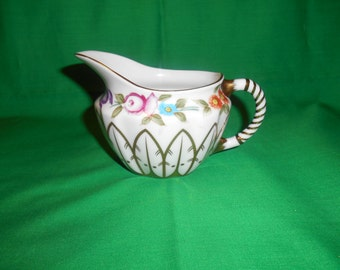 One (1), 6 oz Porcelain Creamer, from Royal Danube