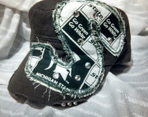 """Michigan State Fabric frayed """"S"""" with bling accents on army green cadet hat"""