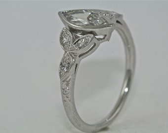 14kt White Gold and Diamond Marquee Engagement Ring with .70ct Marquee Moissanite Center