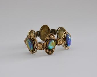 gold tone iridescent stone bracelet