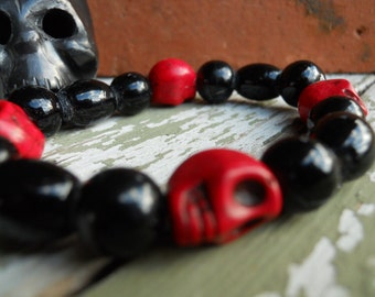The Real Dia de Los Muertos Cardinal Colors Skull bracelet in University of Louisville colors red and black