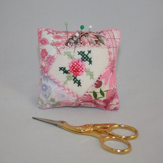 Items similar to pink cross stitch pincushion upcycled