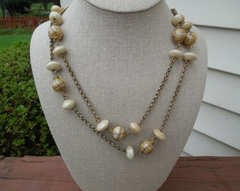 Vintage Chain Necklace.  Long.  Creamy Brown Glass Beads and Spaceship Shape Beads.