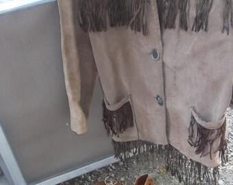 Vintage 1960 fringed original hippie jacket, 3 button front. Original peace patch on shoulder sz. med