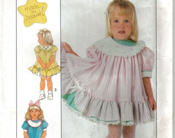 Girl's Child's Ruffled Twirl Dress with Round Yoke Puffed Short Sleeves and Patch Pockets Simplicity 8523 Size 5