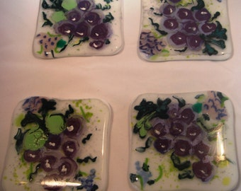 A Set Of Four Fused Glass Coasters With Clusters of Grapes Hand Painted